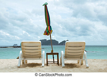Deck chair for relax on the beach - View of a deck chair for...