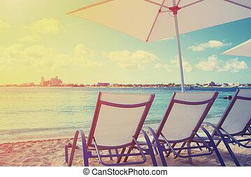 Deck chair on a beautiful beach during sunrise