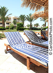 Deck chair - Photo of two striped deck chair in front of a...