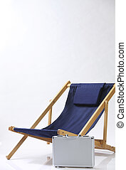 Deck chair made of wooden frame and suitcase