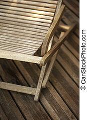 Deck chair - Wooden deck chair on a wooden terrace