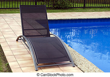 Deck Chair - Deck chairs beside a swimming pool