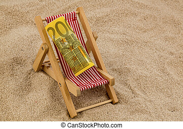 deck chair with euro - a deck chair with a euro. symbolic...