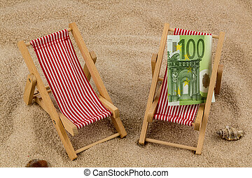 deck chair with euro - deckchair with euro on the sandy...