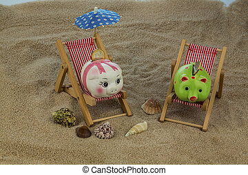 deck chair with piggy bank and euro - deckchair with euro on...
