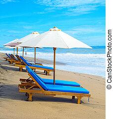 Deck chairs beach parasols, Bali