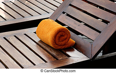 Deck chairs - Close-up of towels at a luxury swimming pool...