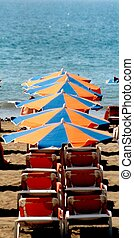 Deck chairs - line of deck chairs and umbrellas infront of...