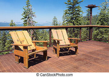 Deck Chairs Mountains - Two wood chairs on outdoor sunny...