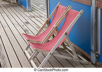 Deck chairs on a pier