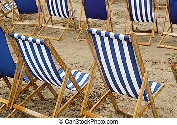 Deck chairs on a sandy beach