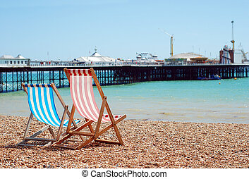 deck chairs on the beach Brighton England on summer day