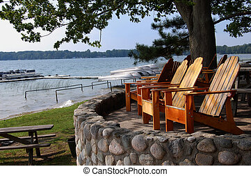 deck chairs overlooking lake with boats