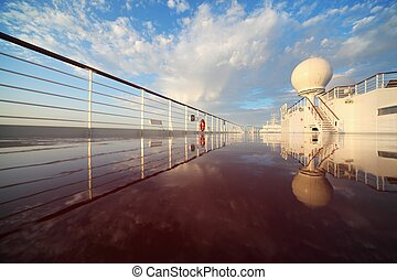 deck of cruise ship shining by morning sun. reflection in deck