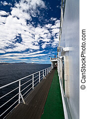 Deck of ferry - Deck of large ferry with ocean and blue sky...