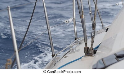Deck of white yacht on background of sea waves in Greece. Closeup