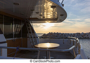 deck of yacht boat and sunset