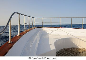 Deck of yacht - Prow of big wooden yacht in the sea