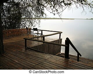 Deck on the lake - 1 - Two chairs on a deck overlooking a...