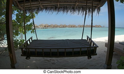 Deck Swing Sways in the Shade at a Resort in the Maldives