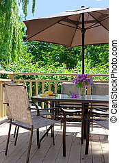 Deck table and chairs - Wooden backyard deck with outdoor ...