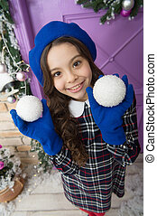 deck the halls. christmas shopping. small french girl. trendy kid decorative xmas ball. home and christmas tree decor. happy new year. smiling parisian child in gloves. winter holiday activity