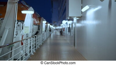 Deck with lifeboats on a cruise ship.