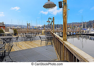 Deck with tables and water view