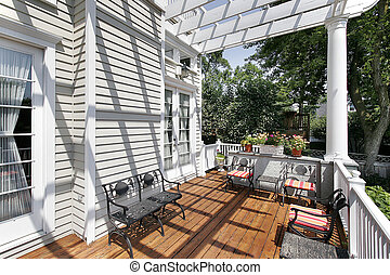 Deck with wrought iron furniture in suburban home