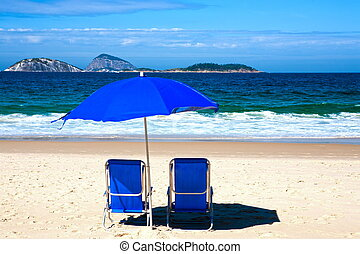 deckchair and umbrella on ipanema beach - blue deckchair on...