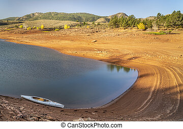 decked expedition canoe on a mountain lake in Colorado - ...