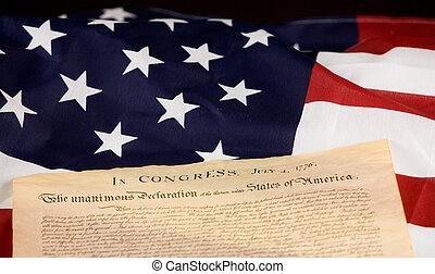 Declaration of Independance against an American flag.