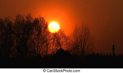 Decline. - Rural spring sunset, time lapse clip.