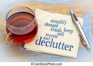 declutter and simplify word cloud on a napkin with a cup of tea