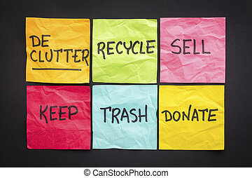 declutter concept (keep, recycle, trash, sell, donate - handwriting on color sticky notes against black paper background
