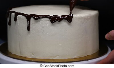 Decor cake by chocolate icing, close-up.
