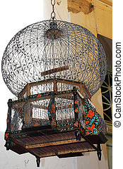Decorated birdcage hanging in a tunisian bazaar