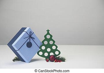 Decorated Christmas balls and Christmas tree with gift box