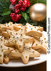 Decorated christmas cookies in festive setting with tree...