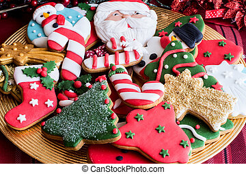 Decorated Christmas cookies on golden plate