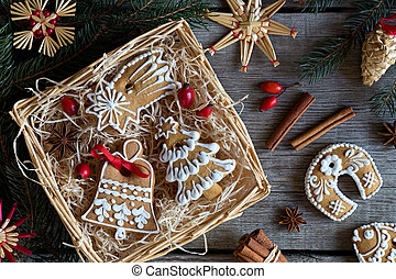 Christmas gingerbread cookies in a square wicker basket on a wooden table