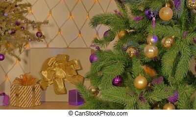 Decorated Christmas tree against the background of a garland