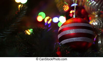 Decorated Christmas tree - Close up of striped ball on...