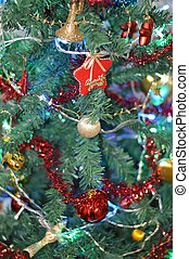 Decorated Christmas tree detail with star, balls and golden...