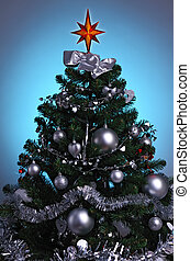 decorated Christmas tree in blue glow background