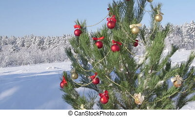 Decorated Christmas tree in snow covered winter forest