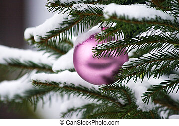 Decorated christmas tree in the snow