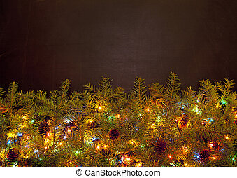 Decorated Christmas tree on black background with copy space