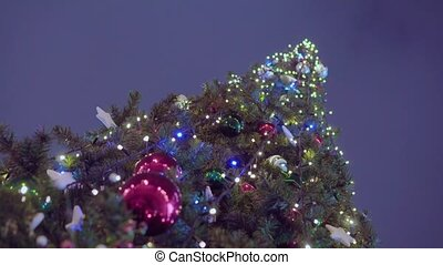 Decorated Christmas tree on the sky background