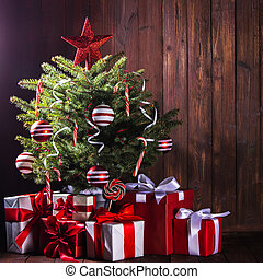 Decorated Christmas tree with candy canes , star , striped...